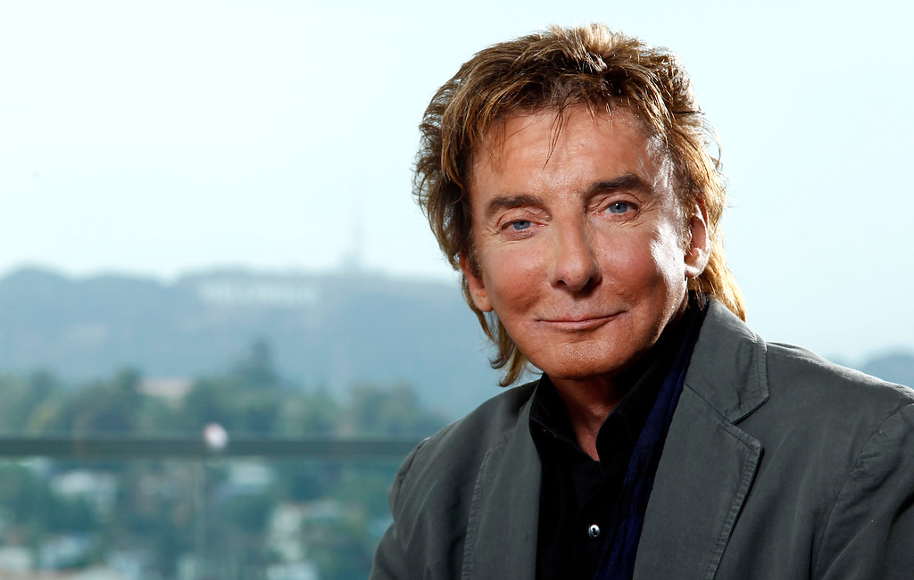 ". FILE - This June 8, 2011 file photo shows musician Barry Manilow poses for a portrait in Los Angeles. The Grammy Award-winning singer of such songs as ""Mandy,\"" \'\'I Write the Songs\"" and \""Looks Like We Made It,\"" will start a 17-performance stand on Jan. 18 at the St. James Theatre. Manilow, who grew up in New York, has graced a Broadway stage before, in the winter of 1976 and the spring of 1989. His new show, called \""Manilow on Broadway,\"" has tickets ranging in price from $50 to $350. (AP Photo/Matt Sayles, file)"