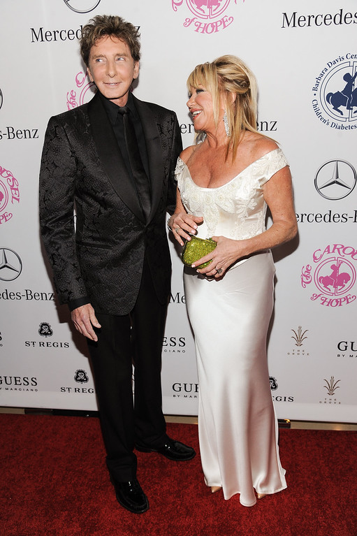 . Barry Manilow, left, and Suzanne Somers arrive at the 2014 Carousel Of Hope Ball on Saturday, Oct. 11, 2014, in Beverly Hills, Calif. (Photo by Richard Shotwell/Invision/AP)