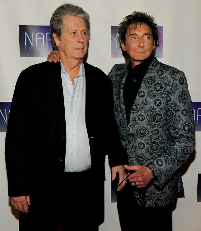. Singers Brian Wilson, left, and Barry Manilow pose together at the National Association of Recording Merchandisers Convention Awards Dinner, Thursday, May 12, 2011, in Los Angeles. (AP Photo/Chris Pizzello)
