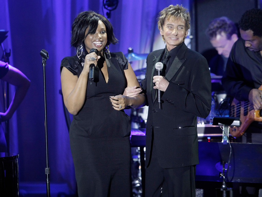 . Singer Jennifer Hudson, left, and singer Barry Manilow perform together at the Clive Davis pre-Grammy party in Beverly Hills, Calif. on Saturday, Feb. 7, 2009. (AP Photo/Dan Steinberg)