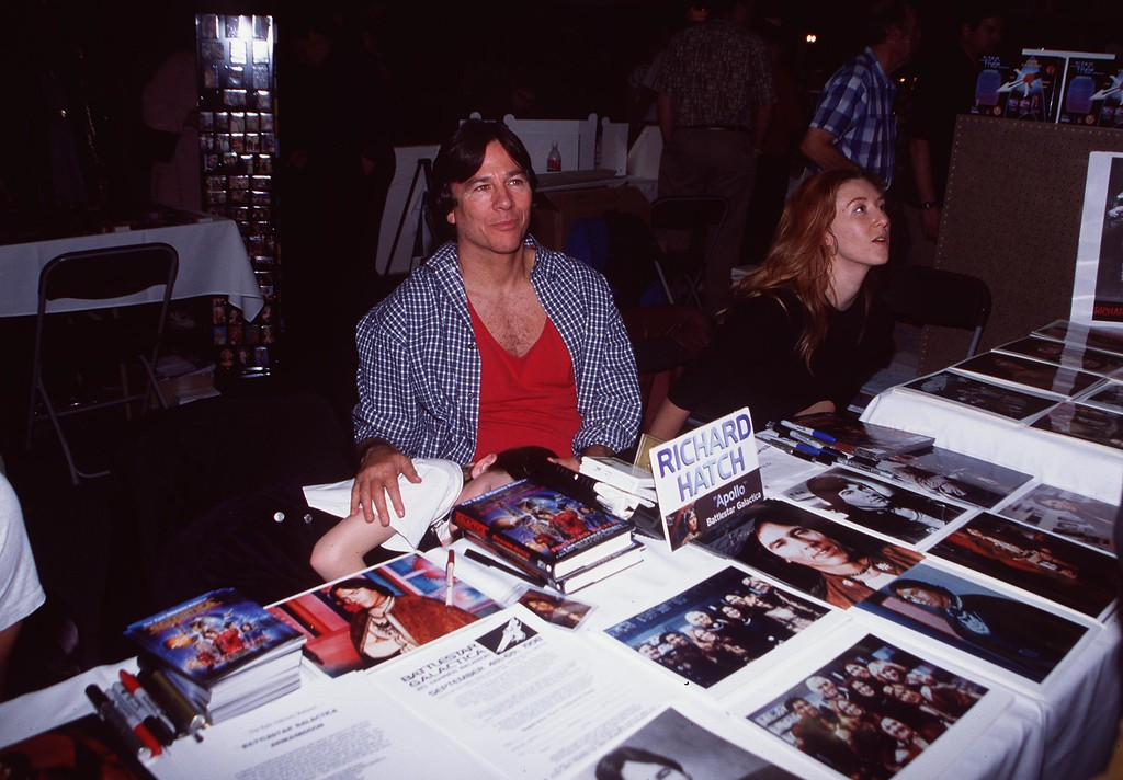""". 4/4/98 Pasadena, CA. Richard Hatch (\""""Battlestar Galactica\"""") with his wife and daughter at the Creation Entertainmentis Grand Slam VI Star Trek Convention. Hatch, perhaps best known for playing Captain Apollo in the original �Battlestar Galactica� film and TV series, has died. He was 71. A representative for the actor says Hatch died Tuesday, February 7, 2017. (Getty Images)"""
