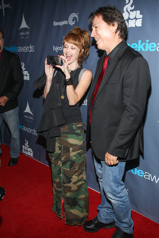. Actor Richard Hatch and guest arrive at the 2013 Geekie Awards at the Avalon on Sunday, Aug. 18, 2013 in Los Angeles. (Photo by Paul A. Hebert/Invision/AP)