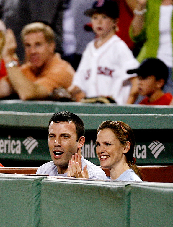 . Ben Affleck and Jennifer Garner cheer at Fenway Park in Boston during the Boston Red Sox\'s baseball game against the Los Angeles Angels Sunday, July 30, 2006. (AP Photo/Winslow Townson)