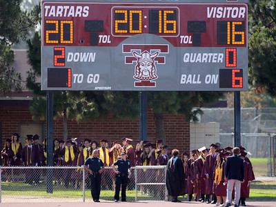 """Commencement ceremony for Torrance High's Class of 2016 Wednesday, June 22, 2016, Zamperini Stadium, Torrance, CA.  The scoreboard at the stadium was set to read """"2016."""" Photo by Steve McCrank/Staff Photographer"""