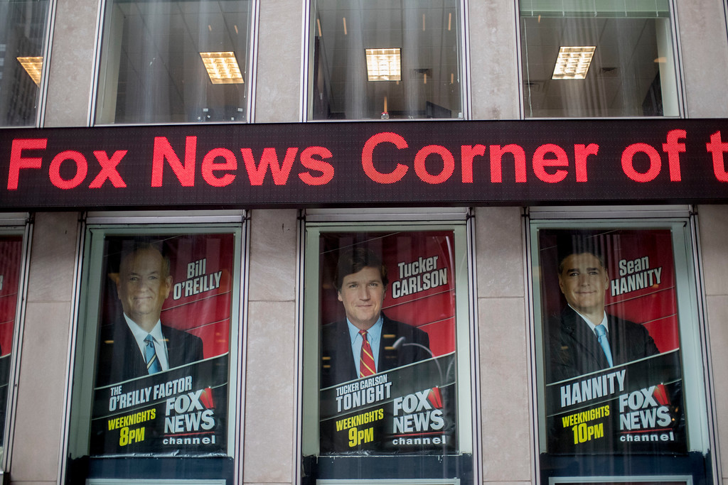 . Posters of Fox News Channel personalities are displayed at the News Corp. headquarters in New York, Wednesday, April 19, 2017. O�Reilly will not be returning to the Fox News Channel, 21st Century Fox said in a statement on Wednesday, April 19, 2017. (AP Photo/Mary Altaffer)