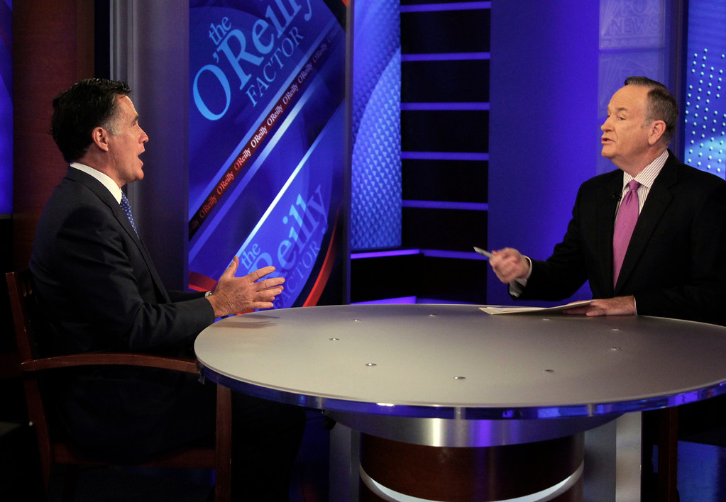 """. Republican presidential candidate and former Massachussetts Gov. Mitt Romney is interviewed by Bill O\'Reilly, right, for his Fox News program \""""The O\'Reilly Factor,\"""" in New York, Monday, Dec. 19, 2011. Romney told O\'Reilly he\'s the candidate who can best fend off Democratic attacks and defeat President Barack Obama in the election next November. (AP Photo/Richard Drew)"""