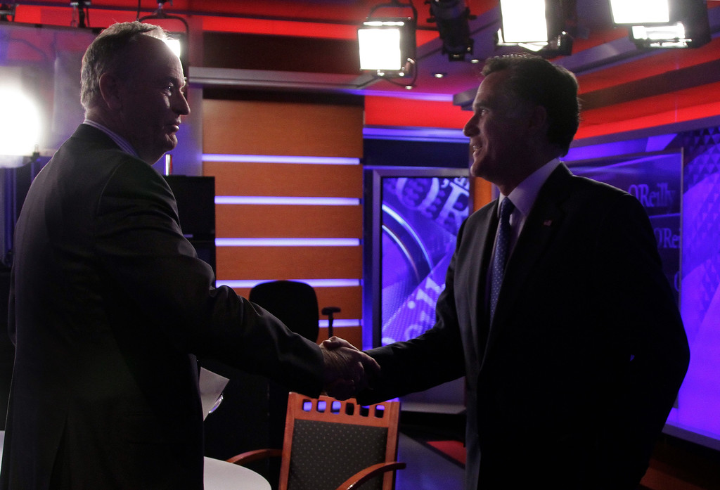". Republican presidential candidate Mitt Romney, right, shakes hands with Bill O\'Reilly after his interview for his Fox News program ""The O\'Reilly Factor,\"" in New York,  Monday, Dec. 19, 2011. (AP Photo/Richard Drew)"