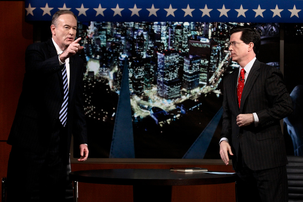 . Fox News commentator Bill O\'Reilly, left, gestures while being interviewed by Stephen Colbert on the Comedy Central show, The Colbert Report,\' Thursday, Jan. 18, 2007 in New York. The two commentators appeared on each others show on Thursday night. (AP Photo/Adam Rountree)
