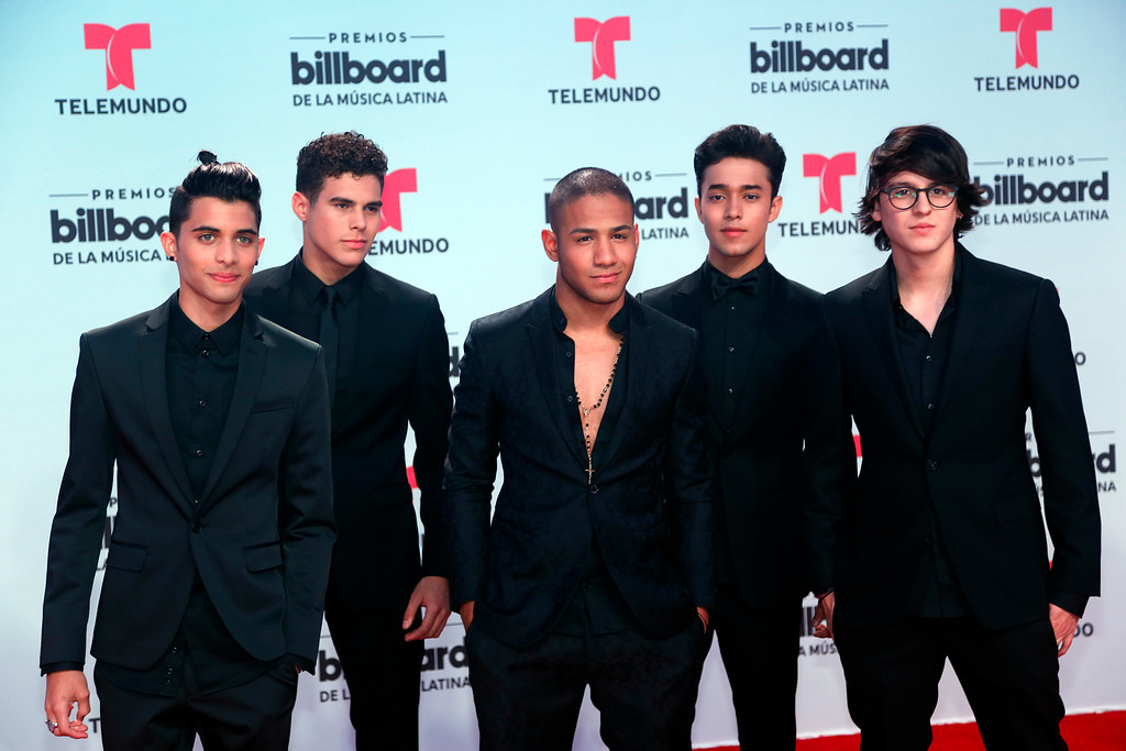 . Members of the band CNCO arrive at the Latin Billboard Awards, Thursday, April 27, 2017 in Coral Gables, Fla. (AP Photo/Wilfredo Lee).