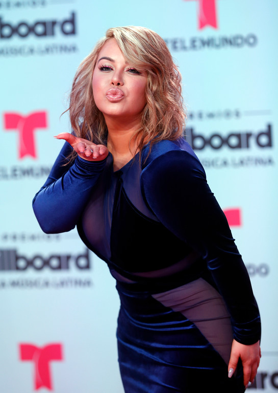 . Singer Chiquis Rivera gestures on the red carpet before the Latin Billboard Awards Thursday, April 27, 2017 in Coral Gables, Fla. (AP Photo/Wilfredo Lee)