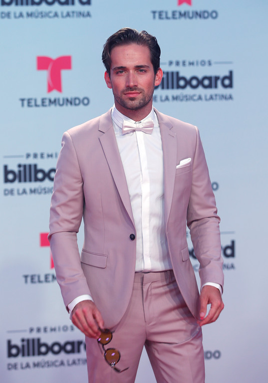. Actor Mauricio Henao arrives at the Latin Billboard Awards, Thursday, April 27, 2017 in Coral Gables, Fla. (AP Photo/Wilfredo Lee).