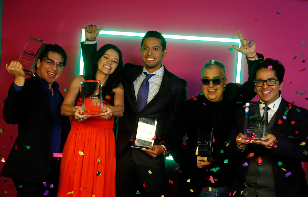 . The family of singer Juan Gabriel, hold his five Latin Billboard Awards, including the Artist of the Year award, Thursday, April 27, 2017 in Coral Gables, Fla. Juan Gabriel passed away in August 2016. (AP Photo/Wilfredo Lee