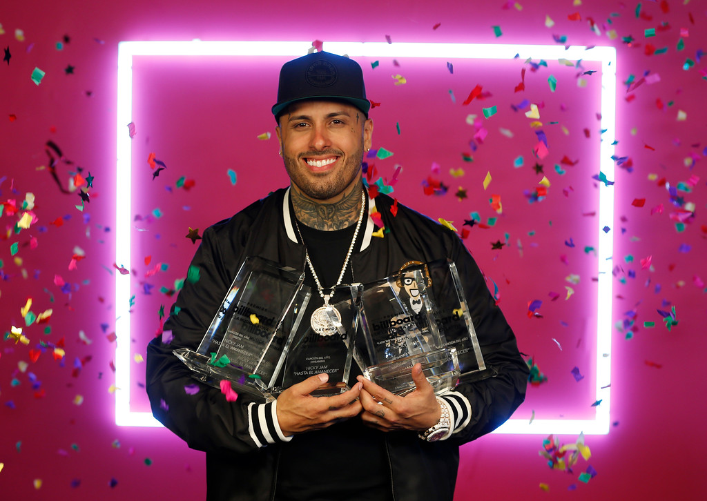 . Singer Nicky Jam holds his six Latin Billboard Awards, Thursday, April 27, 2017 in Coral Gables, Fla. (AP Photo/Wilfredo Lee)