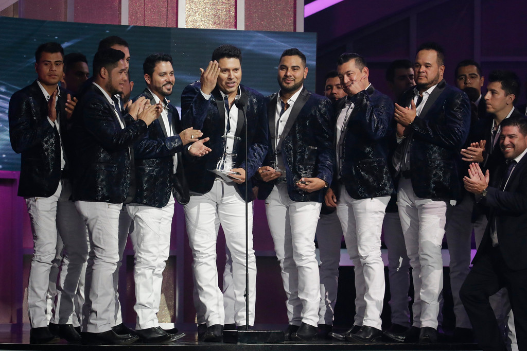 . Members of the Banda Sinaloense MS de Sergio Lizarraga, receive the Regional Mexican Song of the Year award, during the Latin Billboard Awards Thursday, April27, 2017 in Coral Gables, Fla. (AP Photo/Lynne Sladky).