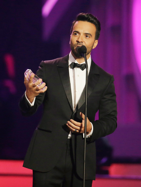 . Singer Luis Fonsi accepts the Billboard Spirit of Hope Award during the Latin Billboard Awards ,Thursday, April 27, 2017, in Coral Gables, Fla. (AP Photo/Lynne Sladky)