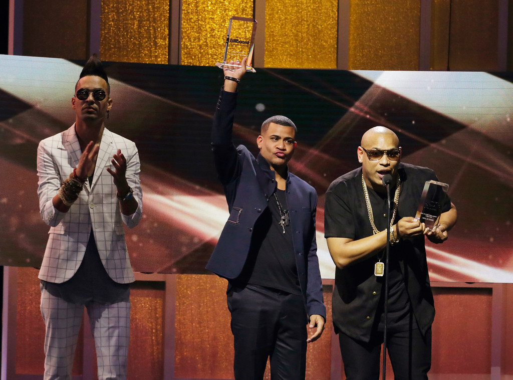 . Gente de Zona accept the Tropical Album Artist of the Year Duo or Group award, during the Latin Billboard Awards, Thursday, April 27, 2017, in Coral Gables, Fla. (AP Photo/Lynne Sladky)