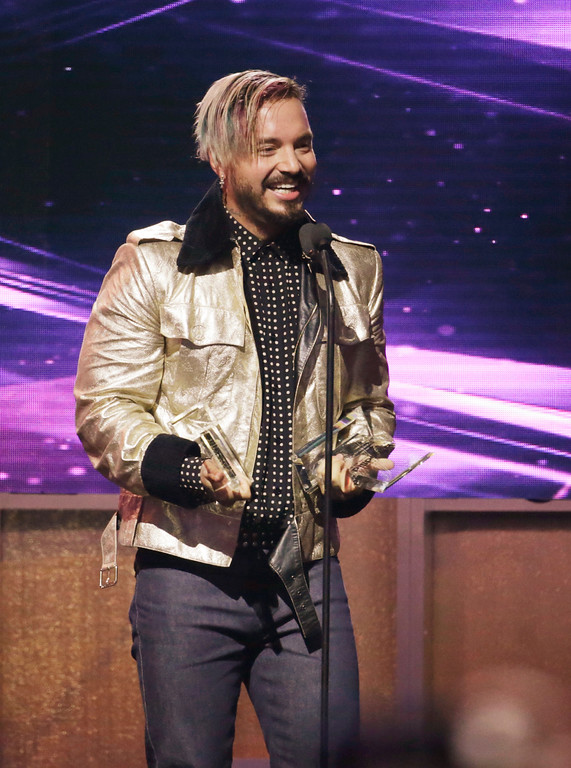 . Singer J Balvin receives the Latin Rhythm Albums Artist of the Year, Solo, during the Latin Billboard Awards Thursday, April 27, 2017, in Coral Gables, Fla. (AP Photo/Lynne Sladky)