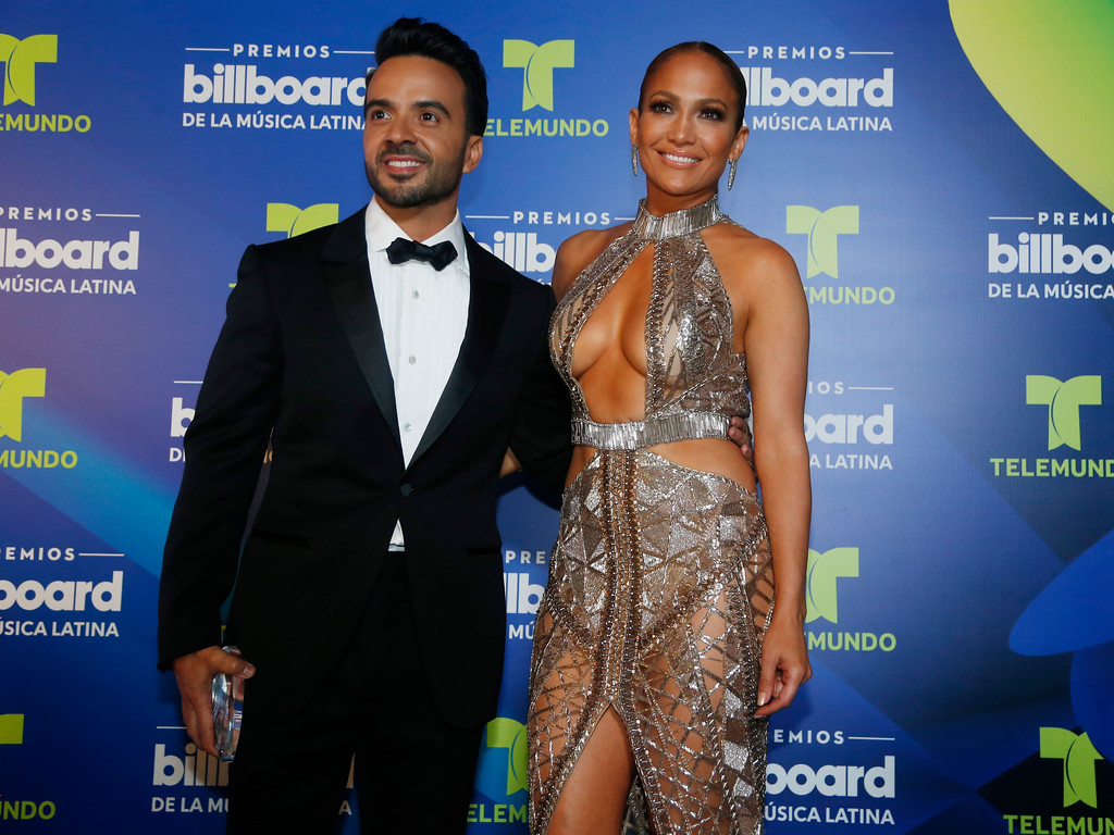 . Singers Luis Fonsi and Jennifer Lopez appear together back stage at the Latin Billboard Awards, Thursday, April 27, 2017 in Coral Gables, Fla. (AP Photo/Wilfredo Lee)