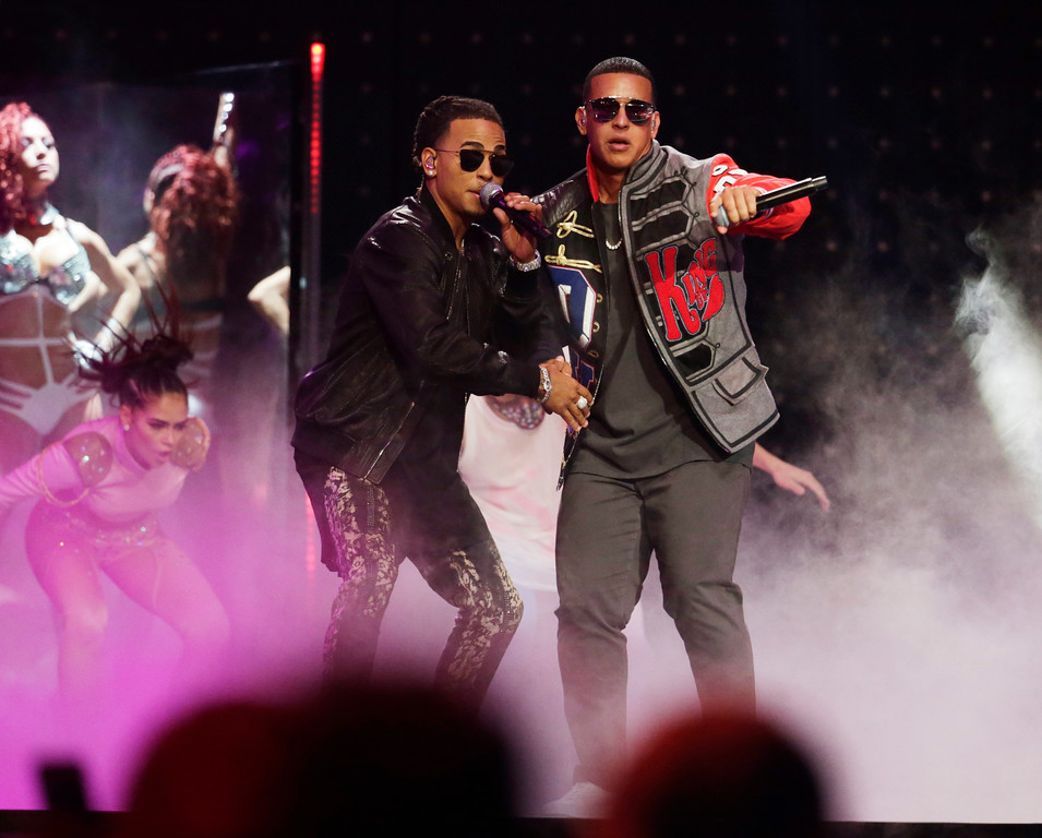 . Singers Ozuna, left and Daddy Yankee perform together at the Latin Billboard Awards, Thursday, April 27, 2017 in Coral Gables, Fla. (AP Photo/Lynne Sladky)