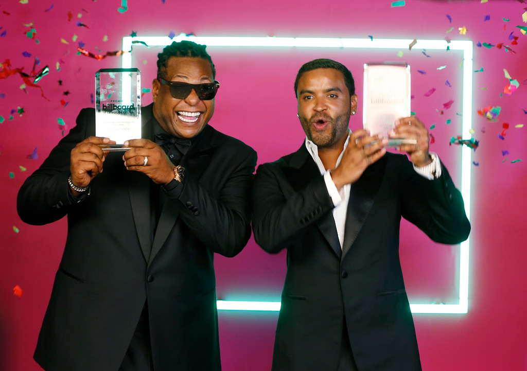 . Singers Zion and Lennox celebrate their Latin Rhythm Songs Artist of the Year, Duo or Group award, at the Latin Billboard Awards, Thursday, April 27, 2017 in Coral Gables, Fla. (AP Photo/Wilfredo Lee)