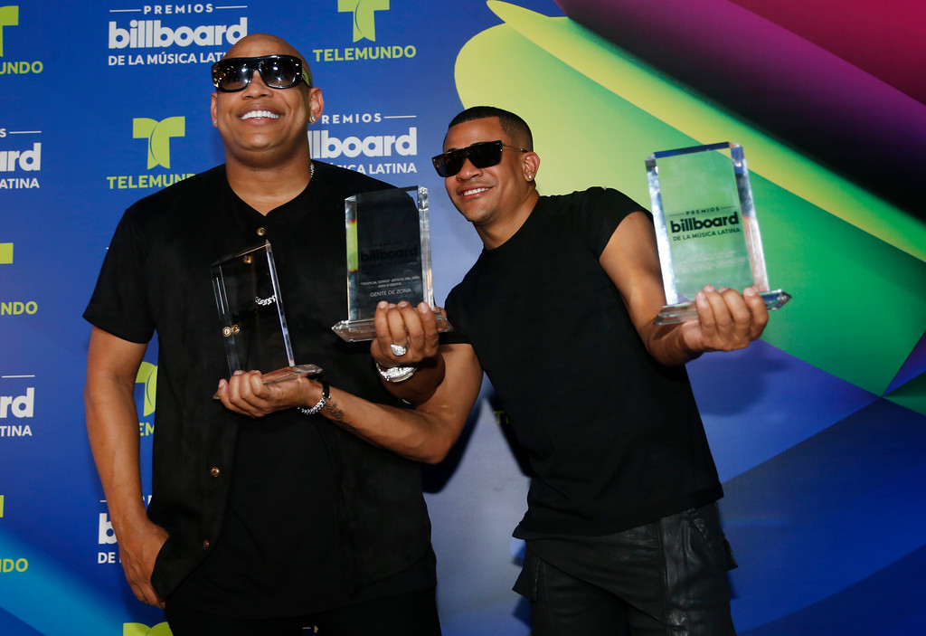 . Gente de Zona show their three Latin Billboard Awards, Thursday, April 27, 2017 in Coral Gables, Fla. (AP Photo/Lynne Sladky)