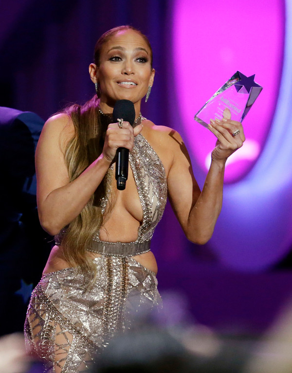 . Singer Jennifer Lopez reacts to receiving the Star Award at the Latin Billboard Awards Thursday, April 27, 2017 in Coral Gables, Fla. (AP Photo/Lynne Sladky).