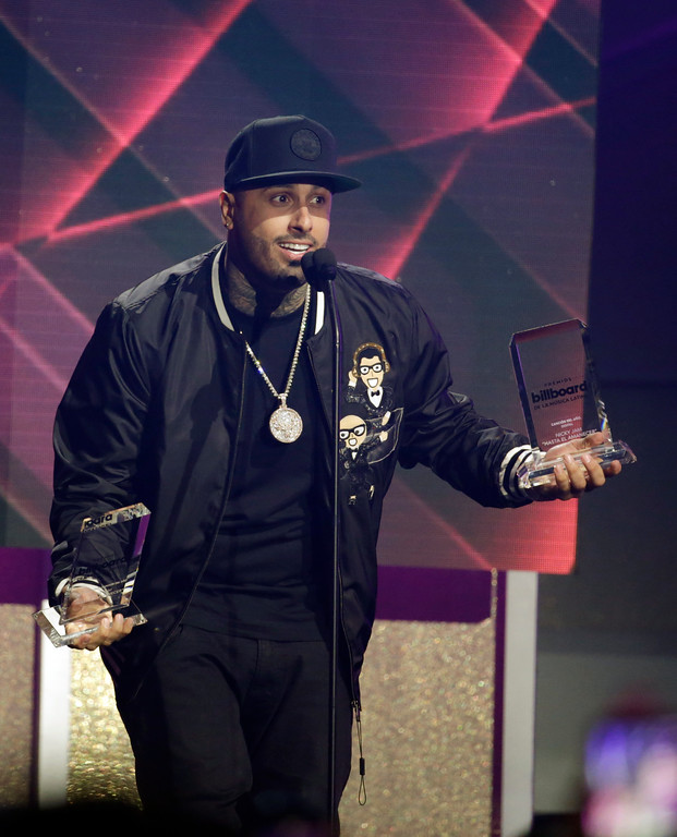 . Singer Nicky Jam holds the Hot Latin Song of the Year award, during the Latin Billboard Awards, Thursday, April 27, 2017 in Coral Gables, Fla. (AP Photo/Lynne Sladky)
