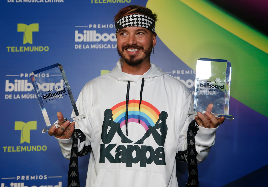 . J Balvin holds his Latin Billboard Awards Thursday, April 27, 2017 in Coral Gables, Fla. (AP Photo/Wilfredo Lee)