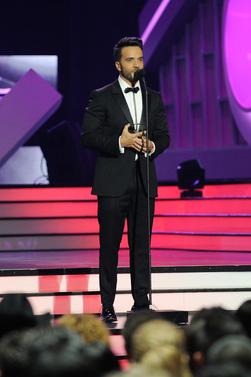 . CORAL GABLES, FL - APRIL 27:  Luis Fonsi accepts an award onstage at the Billboard Latin Music Awards at Watsco Center on April 27, 2017 in Coral Gables, Florida.  (Photo by Sergi Alexander/Getty Images)