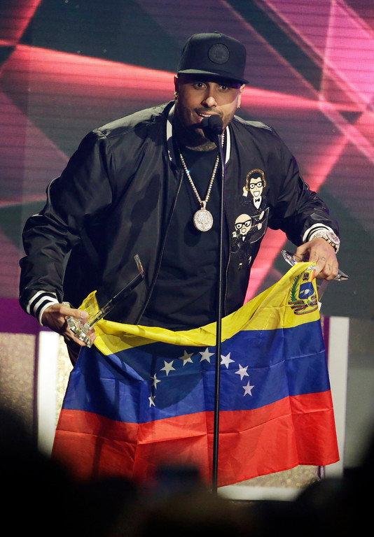 . Singer Nicky Jam holds the Venezuelan flag during the Latin Billboard Awards Thursday, April 27, 2017 in Coral Gables, Fla. Jam won six awards including Hot Latin Songs Artist of the Year award. (AP Photo/Lynne Sladky)