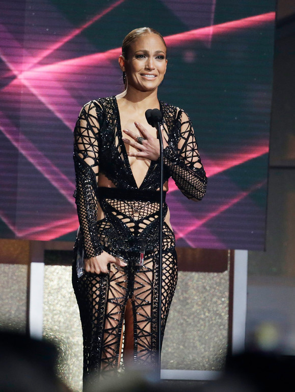 . Singer Jennifer Lopez reacts to receiving the Social Artist of the Year, during the Latin Billboard Awards, Thursday, April 27, 2017, in Coral Gables, Fla. (AP Photo/Lynne Sladky)