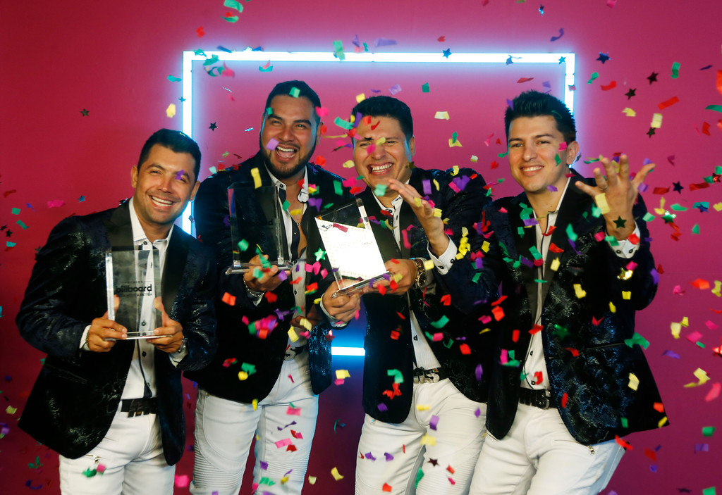 . Members of the Banda Sinaloense MS de Sergio Lizarraga, celebrate the Regional Mexican Song of the Year award, during the Latin Billboard Awards Thursday, April27, 2017 in Coral Gables, Fla. (AP Photo/Wilfredo Lee)