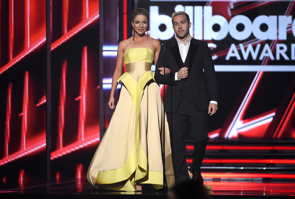 . Kira Kazantsev, left, and Pete Wentz present the award for top touring artist at the Billboard Music Awards at the MGM Grand Garden Arena on Sunday, May 17, 2015, in Las Vegas. (Photo by Chris Pizzello/Invision/AP)