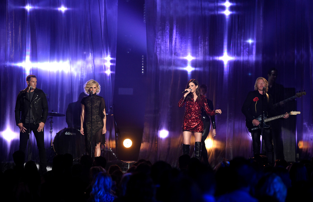 . Jimi Westbrook, from left, Kimberly Schlapman, Karen Fairchild, and Phillip Sweet of Little Big Town perform at the Billboard Music Awards at the MGM Grand Garden Arena on Sunday, May 17, 2015, in Las Vegas. (Photo by Chris Pizzello/Invision/AP)