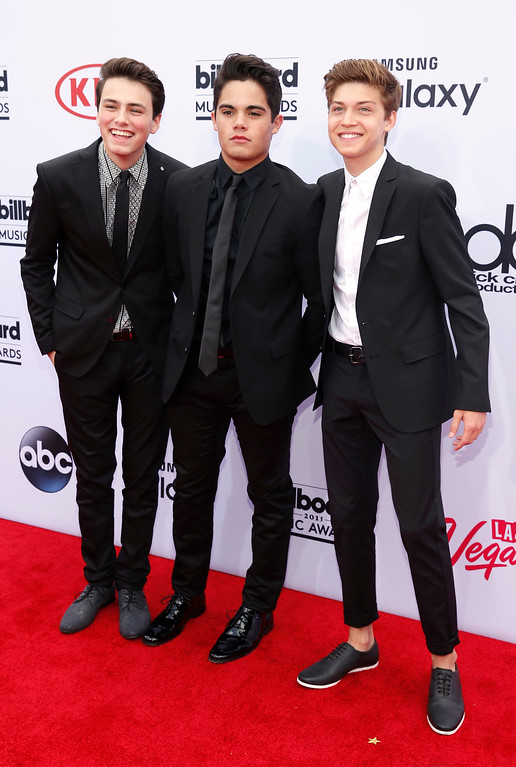 . Liam Attridge, from left, Emery Kelly, and Ricky Garcia of the musical group Forever in Your Mind arrive at the Billboard Music Awards at the MGM Grand Garden Arena on Sunday, May 17, 2015, in Las Vegas. (Photo by Eric Jamison/Invision/AP)