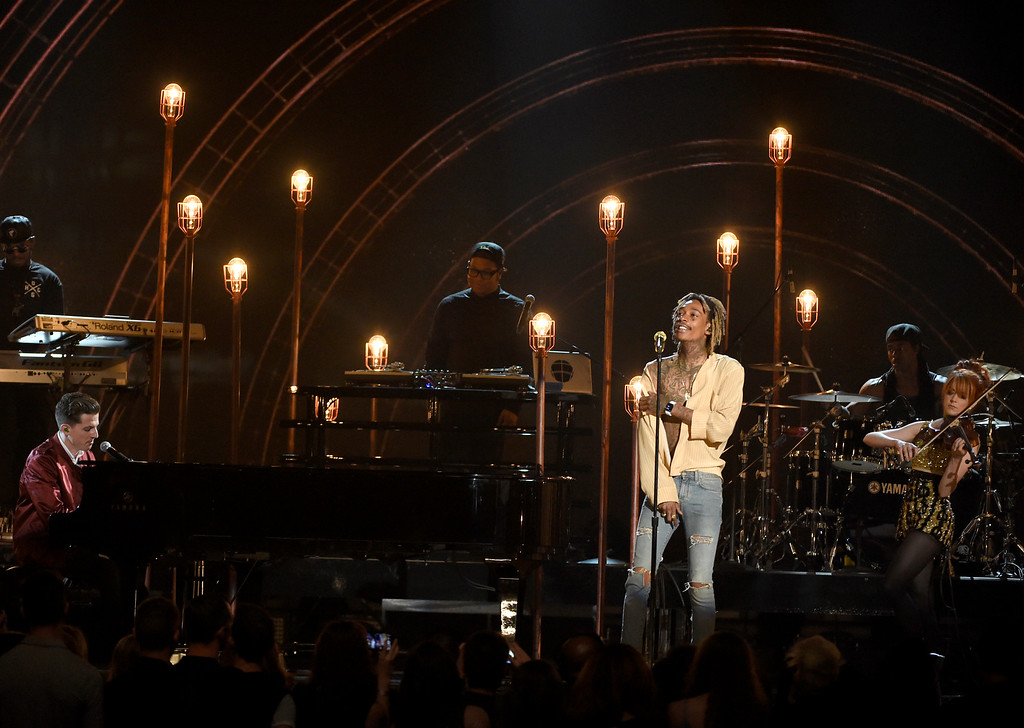. Charlie Puth, from left, Wiz Khalifa, and Lindsey Stirling perform at the Billboard Music Awards at the MGM Grand Garden Arena on Sunday, May 17, 2015, in Las Vegas. (Photo by Chris Pizzello/Invision/AP)