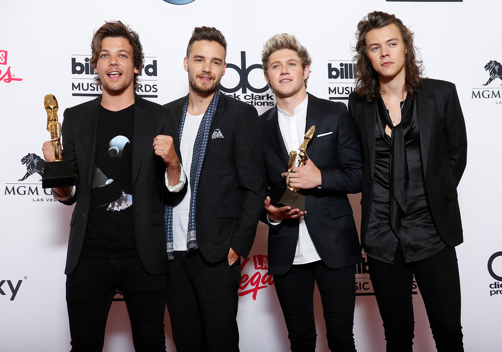 . Louis Tomlinson, from left, Liam Payne, Niall Horan, and Harry Styles of the musical group One Direction pose in the press room with the awards for top duo/group and top touring artist at the Billboard Music Awards at the MGM Grand Garden Arena on Sunday, May 17, 2015, in Las Vegas. (Photo by Eric Jamison/Invision/AP)