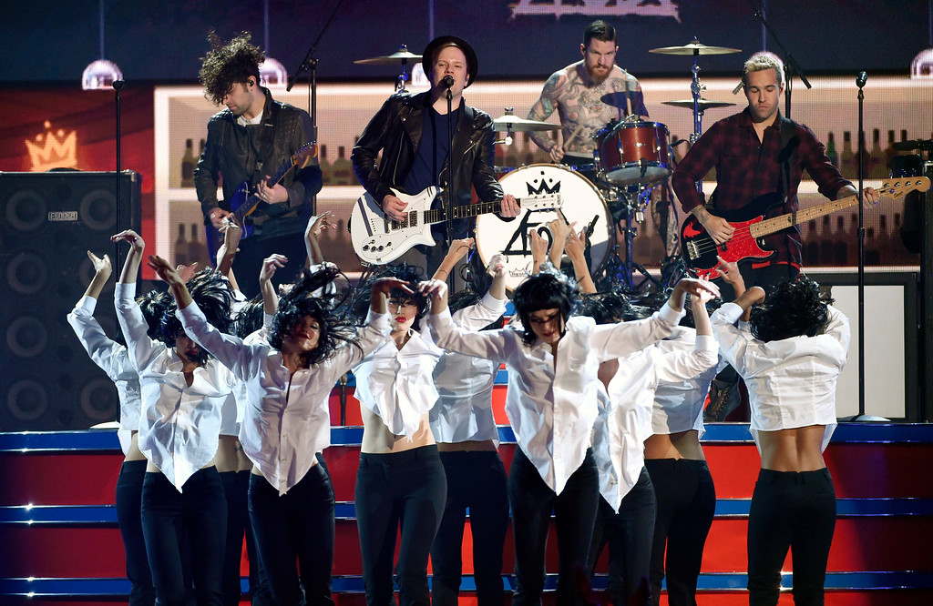 . Joe Trohman, from left, Patrick Stump, Andy Hurley, and Pete Wentz of Fall Out Boy perform at the Billboard Music Awards at the MGM Grand Garden Arena on Sunday, May 17, 2015, in Las Vegas. (Photo by Chris Pizzello/Invision/AP)