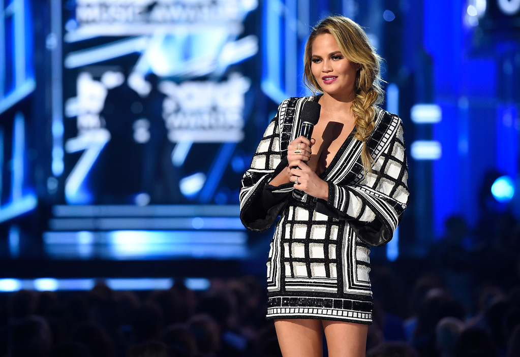 . Host Chrissy Teigen speaks at the Billboard Music Awards at the MGM Grand Garden Arena on Sunday, May 17, 2015, in Las Vegas. (Photo by Chris Pizzello/Invision/AP)