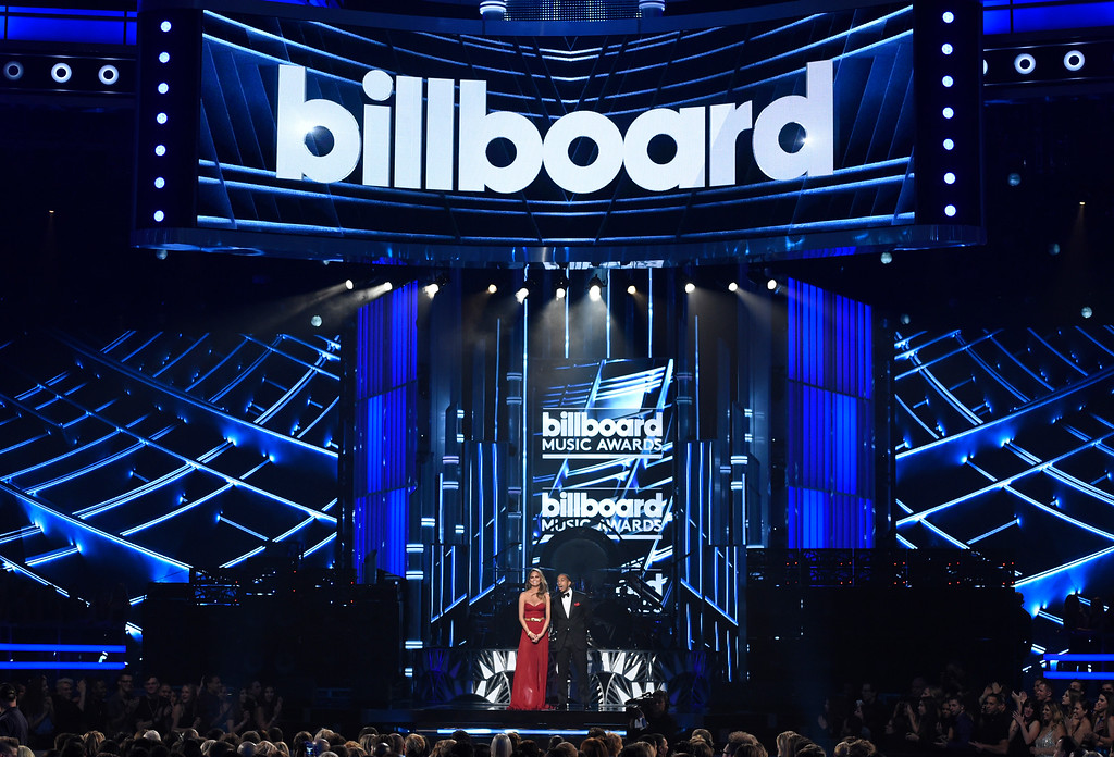 . Hosts Chrissy Teigen, left, and Ludacris speak at the Billboard Music Awards at the MGM Grand Garden Arena on Sunday, May 17, 2015, in Las Vegas. (Photo by Chris Pizzello/Invision/AP)