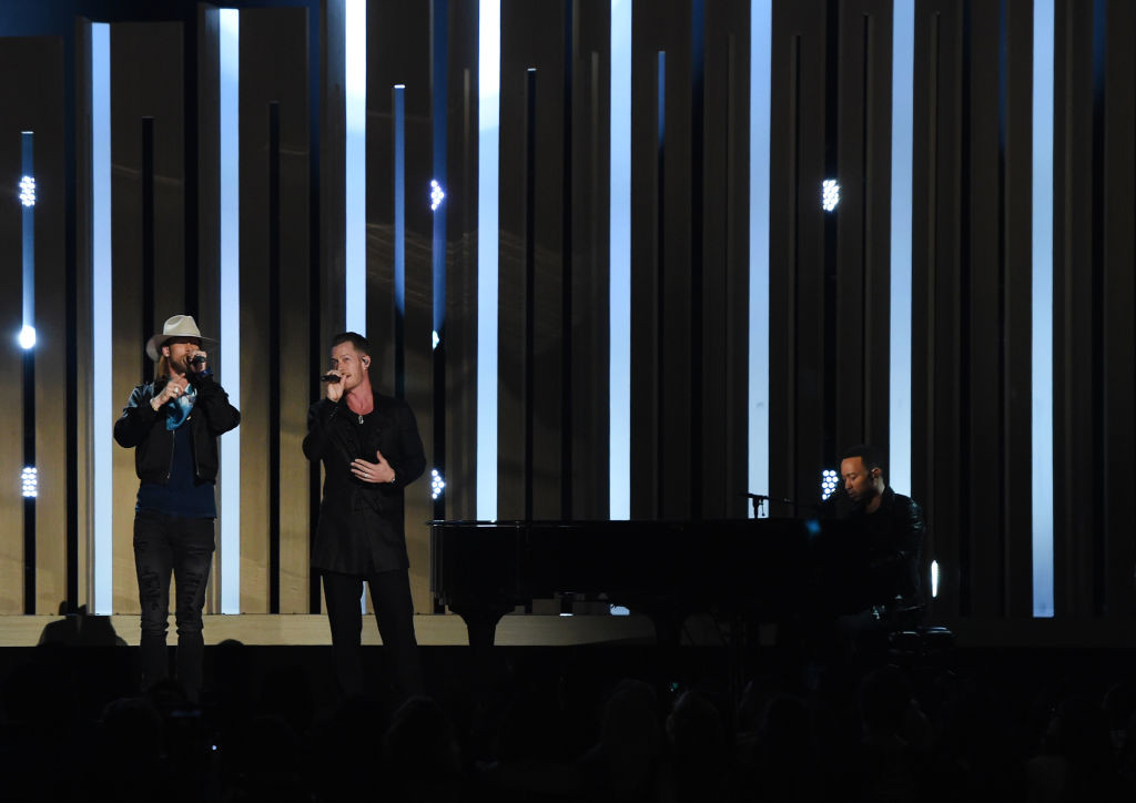 . LAS VEGAS, NV - MAY 21:  (L-R) Musicians Brian Kelley and Tyler Hubbard of Florida Georgia Line with John Legend perform onstage during the 2017 Billboard Music Awards at T-Mobile Arena on May 21, 2017 in Las Vegas, Nevada.  (Photo by Ethan Miller/Getty Images)
