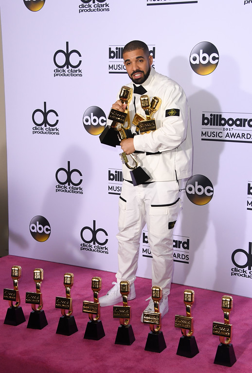 . Rapper Drake poses in the press room with his awards during the 2017 Billboard Music Awards at the T-Mobile Arena on May 21, 2017 in Las Vegas, Nevada. Drake won for Top Artist, Top Male Artist, Top Billboard 200 Artist, Top Billboard 200 Album for \'Views,\' Top Hot 100 Artist, Top Song Sales Artist, Top Streaming Artist, Top Streaming Song (Audio) for \'One Dance,\' Top R&B Song for \'One Dance,\' Top R&B Collaboration for \'One Dance,\' Top Rap Artist, Top Rap Album for \'Views,\' and Top Rap Tour. / AFP PHOTO / MARK RALSTON        (Photo credit should read MARK RALSTON/AFP/Getty Images)
