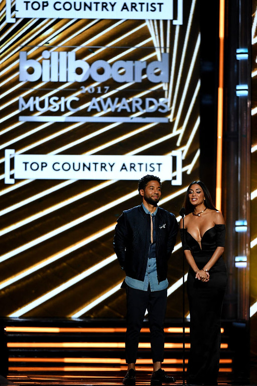 . LAS VEGAS, NV - MAY 21:  Actor Jussie Smollett (L) and singer Nicole Scherzinger speak onstage during the 2017 Billboard Music Awards at T-Mobile Arena on May 21, 2017 in Las Vegas, Nevada.  (Photo by Ethan Miller/Getty Images)