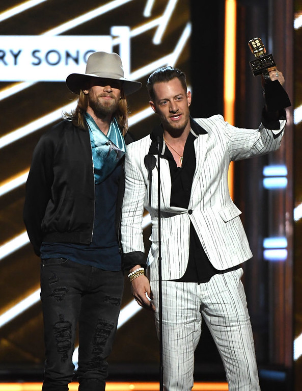 . LAS VEGAS, NV - MAY 21:  Musicians Brian Kelley (L) and Tyler Hubbard of Florida Georgia Line accept Top Country Song for \'H.O.L.Y.\' onstage during the 2017 Billboard Music Awards at T-Mobile Arena on May 21, 2017 in Las Vegas, Nevada.  (Photo by Ethan Miller/Getty Images)