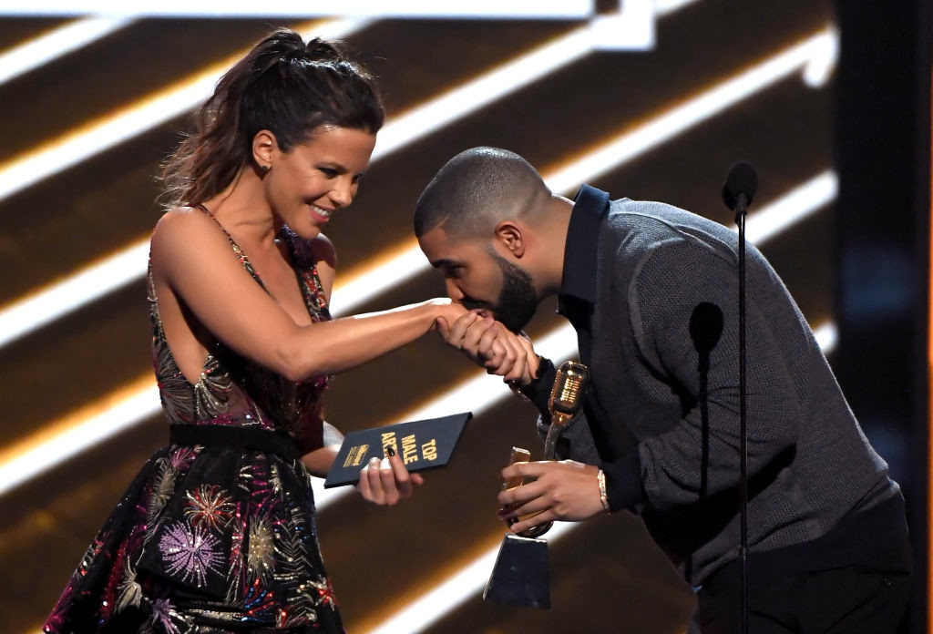 . LAS VEGAS, NV - MAY 21:  Rapper Drake (R) accepts Top Male Artist from actor Kate Beckinsale onstage during the 2017 Billboard Music Awards at T-Mobile Arena on May 21, 2017 in Las Vegas, Nevada.  (Photo by Ethan Miller/Getty Images)