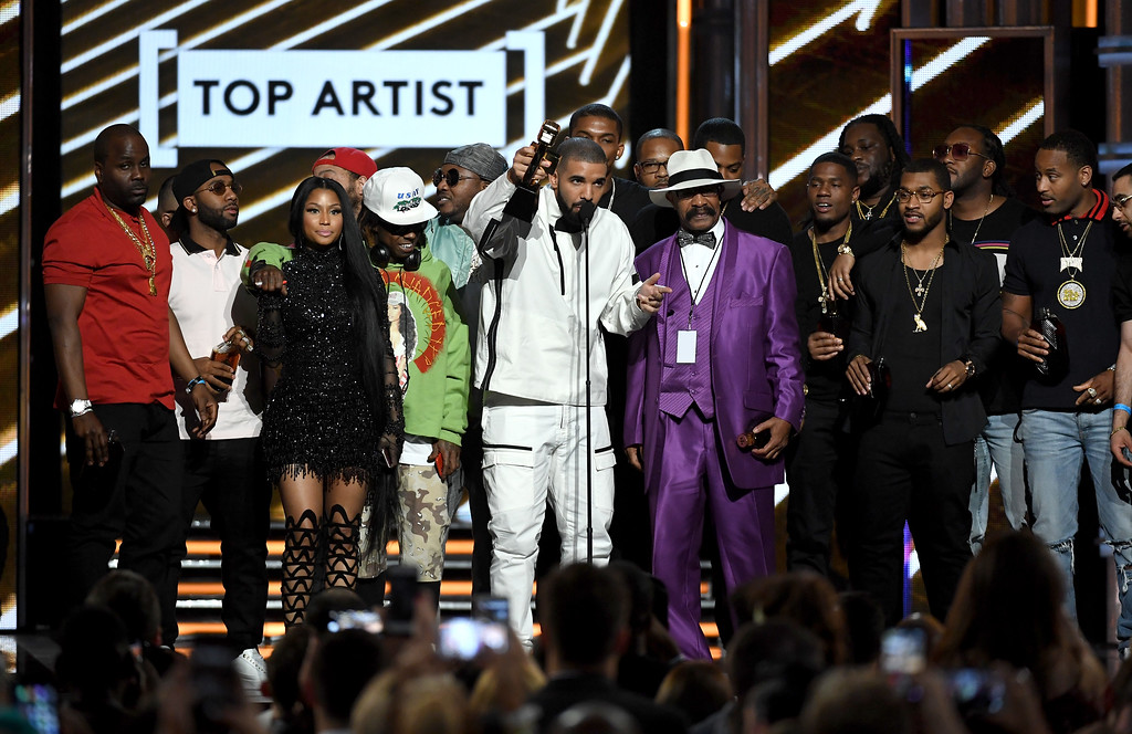 . LAS VEGAS, NV - MAY 21:  Rapper Drake (C) accepts the Top Artist award onstage with songwriters, producers and father Dennis Graham during the 2017 Billboard Music Awards at T-Mobile Arena on May 21, 2017 in Las Vegas, Nevada.  (Photo by Ethan Miller/Getty Images)