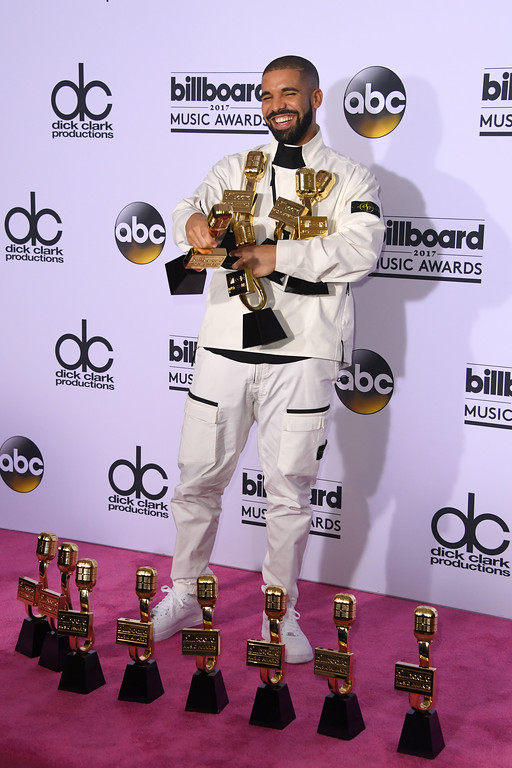 . Rapper Drake poses in the press room with his awards during the 2017 Billboard Music Awards at the T-Mobile Arena on May 21, 2017 in Las Vegas, Nevada. Drake won for Top Artist, Top Male Artist, Top Billboard 200 Artist, Top Billboard 200 Album for \'Views,\' Top Hot 100 Artist, Top Song Sales Artist, Top Streaming Artist, Top Streaming Song (Audio) for \'One Dance,\' Top R&B Song for \'One Dance,\' Top R&B Collaboration for \'One Dance,\' Top Rap Artist, Top Rap Album for \'Views,\' and Top Rap Tour. (MARK RALSTON/AFP/Getty Images)