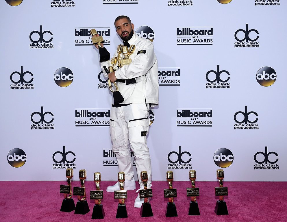 . LAS VEGAS, NV - MAY 21:  Rapper Drake poses in the press room with his awards for Top Artist, Top Male Artist, Top Billboard 200 Artist, Top Billboard 200 Album for \'Views,\' Top Hot 100 Artist, Top Song Sales Artist, Top Streaming Artist, Top Streaming Song (Audio) for \'One Dance,\' Top R&B Song for \'One Dance,\' Top R&B Collaboration for \'One Dance,\' Top Rap Artist, Top Rap Album for \'Views,\' and Top Rap Tour during the 2017 Billboard Music Awards at T-Mobile Arena on May 21, 2017 in Las Vegas, Nevada.  (Photo by David Becker/Getty Images)