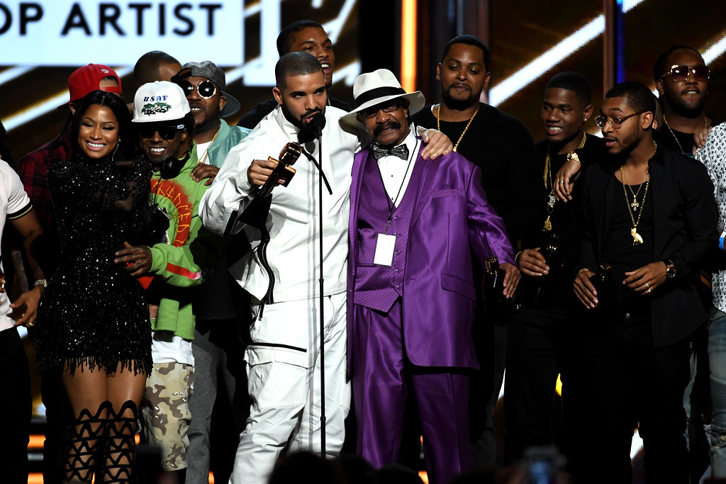 . LAS VEGAS, NV - MAY 21:  Rapper Drake (C) accepts the Top Artist award onstage during the 2017 Billboard Music Awards at T-Mobile Arena on May 21, 2017 in Las Vegas, Nevada.  (Photo by Ethan Miller/Getty Images)