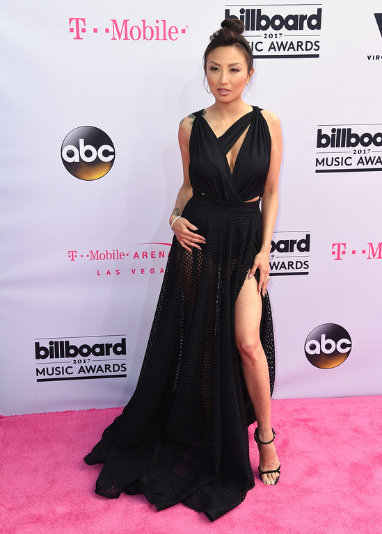 . Jeannie Mai arrives at the Billboard Music Awards at the T-Mobile Arena on Sunday, May 21, 2017, in Las Vegas. (Photo by Richard Shotwell/Invision/AP)